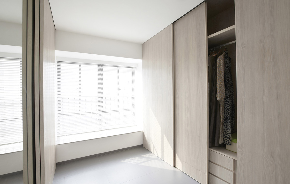 Sliding wardrobe in modern dressing room.