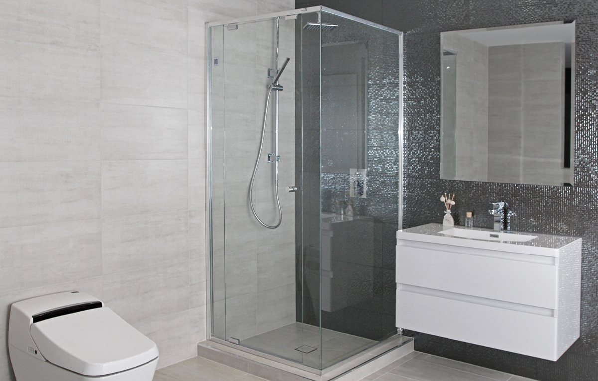 Semi frameless shower screen in modern tiled bathroom.