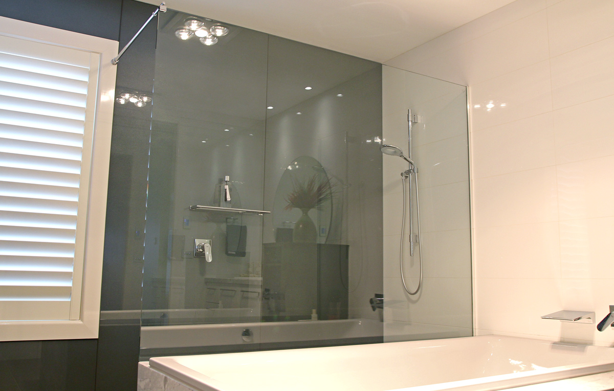 Framless glass shower screen.