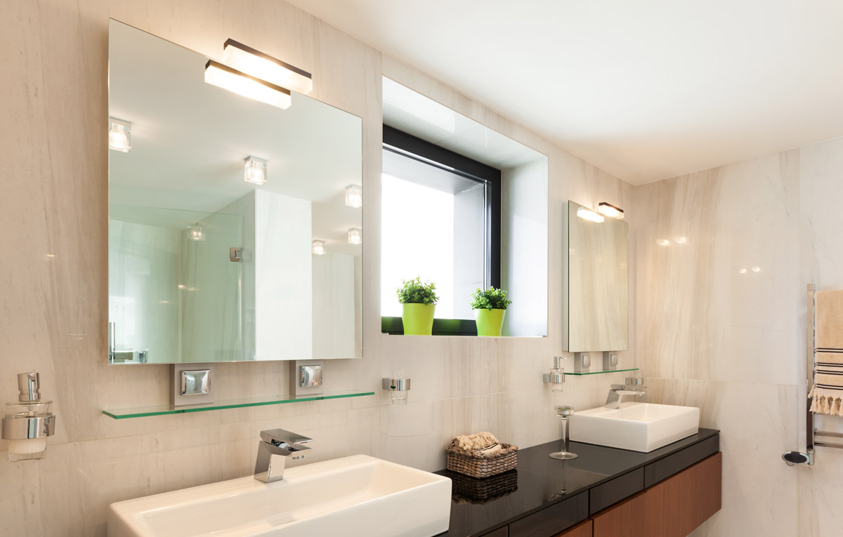 Stylish bathroom with frame less his and hers mirrors.