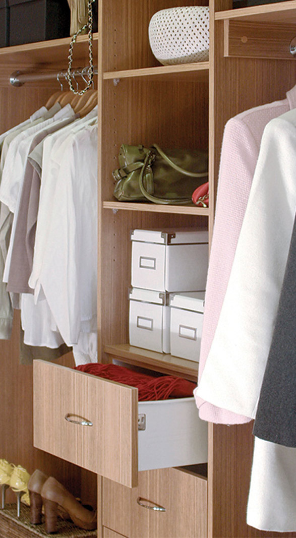 Walk in wardrobe with open drawer.
