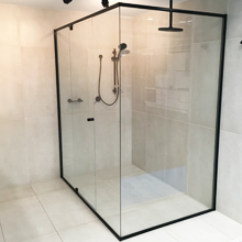 Black semi frame less shower screen with central door