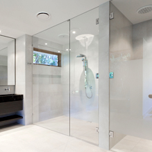 Frame less double door shower screen with 3 hinged doors.