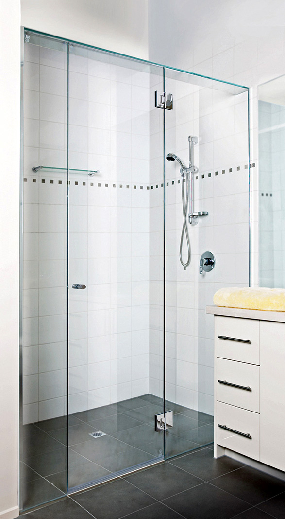 Frame less shower screen with centre door.