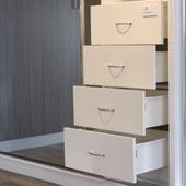 White drawers with standard chrome handle.