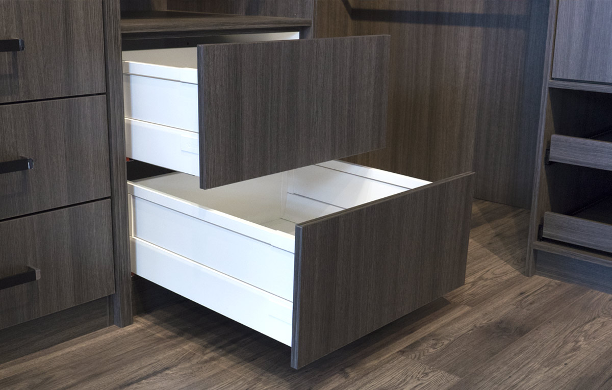 White sliding drawer in walk in robe.