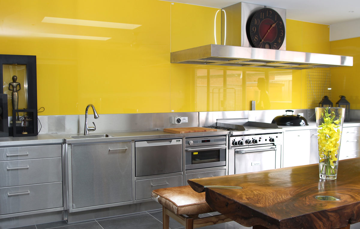 Bright Yellow glass splash back to ceiling.